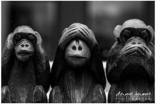 three wise monkeys wooden statues